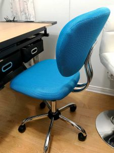 blue office chair at a drawing desk