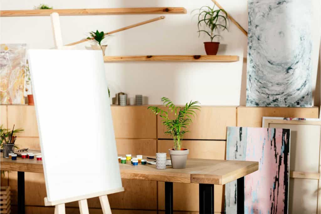 artist studio with blank canvas on an easel