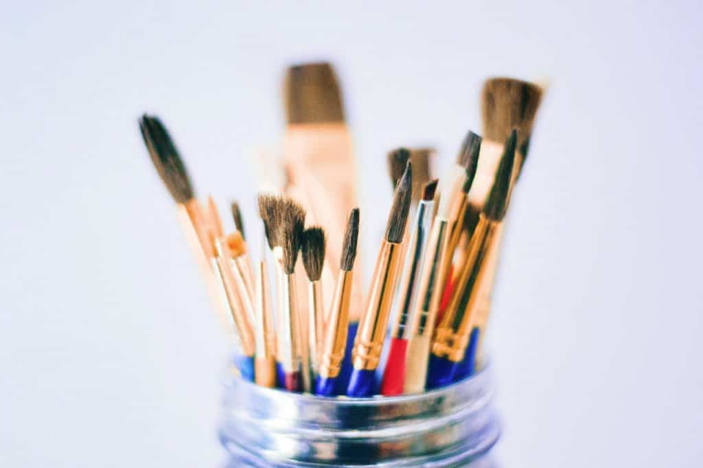 jar filled with artist brushes