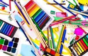 colored pencils, sharpeners, paint and sketchbooks