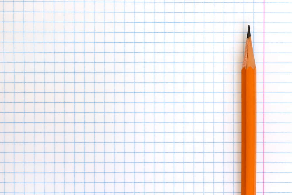 graph paper and an orange lead pencil