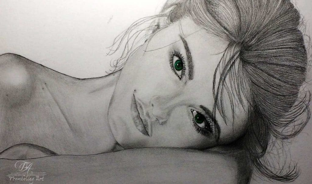 graphite drawing of a girl with green eyes