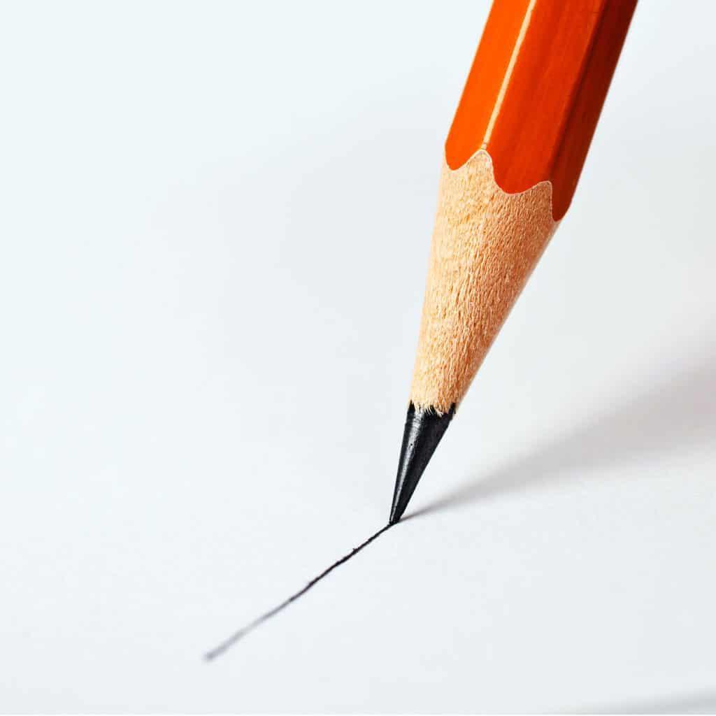 orange pencil on paper