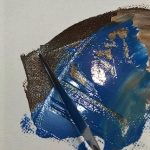 blue and brown paint and painting knife on canvas