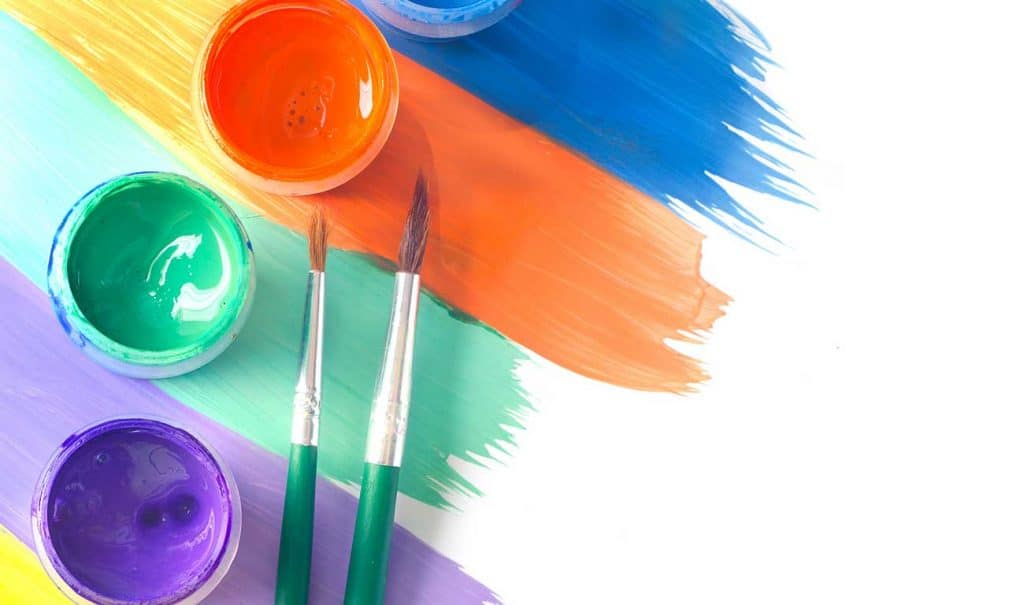various hues of paint and paint brushes