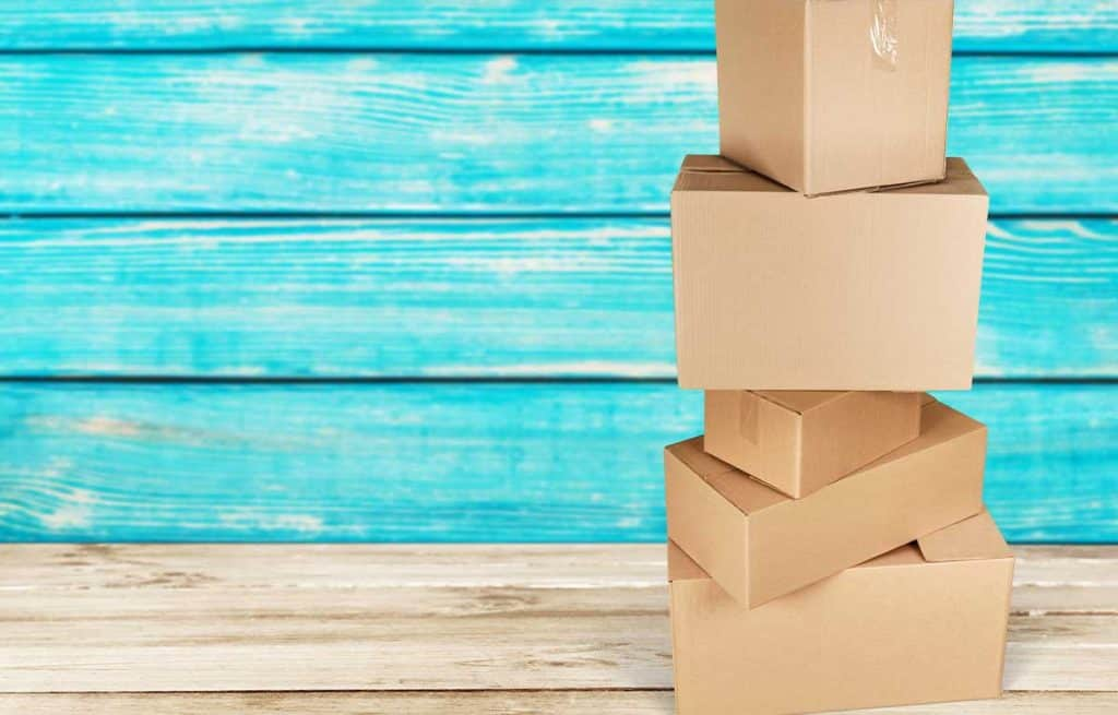 plain shipping boxes against a blue background