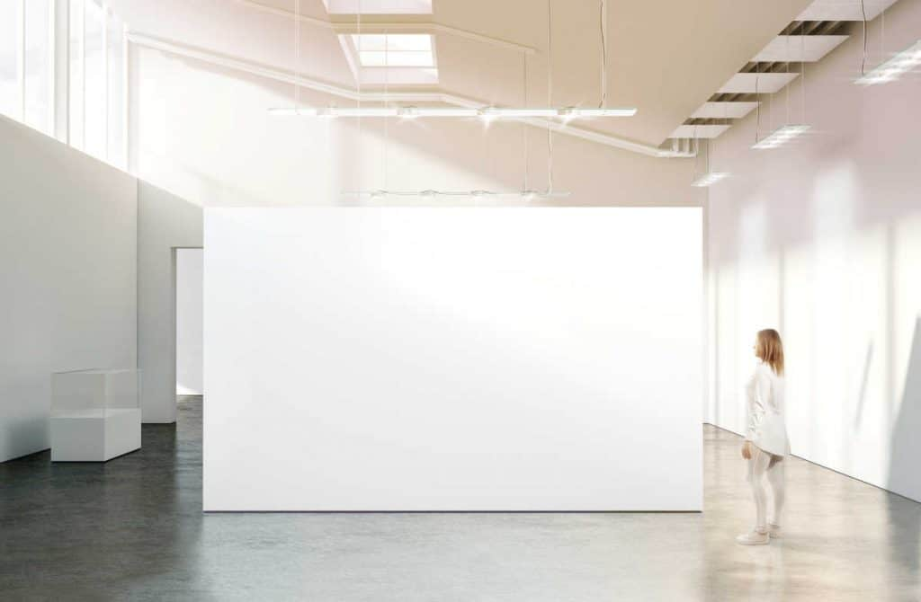 very large blank canvas in a gallery with a girl looking on