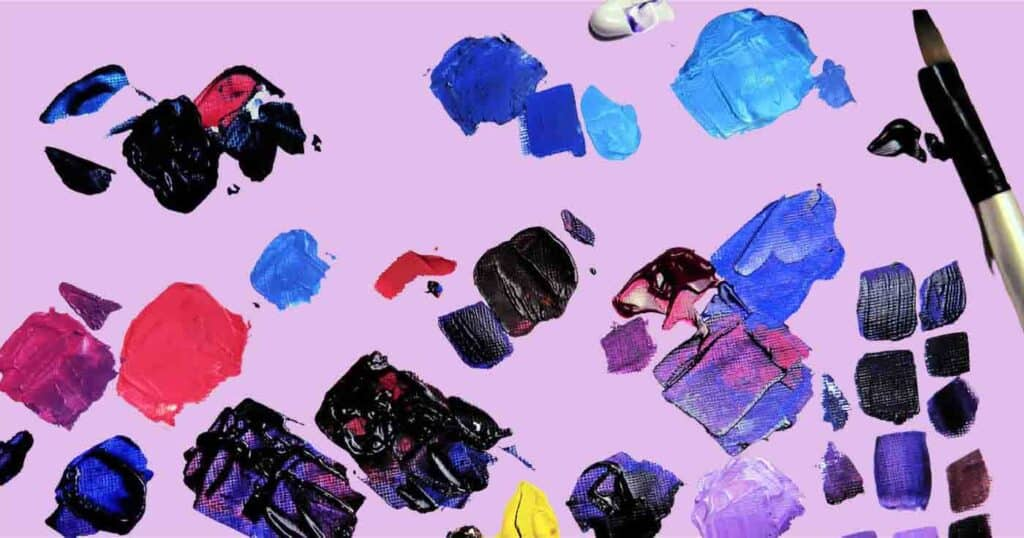 blobs of various colored paints on a purple background