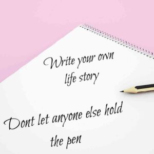 white notebook and pencil on a pink background with quote